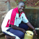 The Water Project: Eluhobe Community, Amadi Spring -  Makutwa Dickson Fetches Clean Water