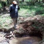 The Water Project: Mkunzulu Community, Museywa Spring -  Mr Shadrack Muuchi Showing Us The Spring
