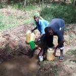 The Water Project: Mkunzulu Community, Museywa Spring -  Fetching Water