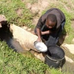 The Water Project: Timbito Community, Wakamu Spring -  Fetching Water