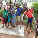 The Water Project: Nyira Community, Ondiek Spring -  A Welcome Smile For The Latrine Slab