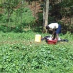 The Water Project: Mudete Community, Wadimbu Spring -  Woman Washing Clothes By The Spring
