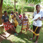 The Water Project: Nyira Community, Ondiek Spring -  Sylvia Midecha Leading Focused Group Discussion On Sound Hygienic Practices