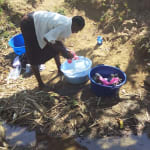 The Water Project: Ematiha Community, Ayubu Spring -  Alice Doing Laundry At The Spring