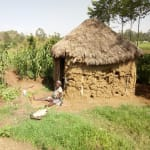 The Water Project: Timbito Community, Wakamu Spring -  Benjamin And His Wife Outside Their Home