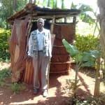 The Water Project: Mudete Community, Wadimbu Spring -  Mr Zephan Adanji At His Latrine