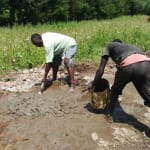 The Water Project: Timbito Community, Wakamu Spring -  Mixing Cement