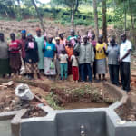 The Water Project: Mkunzulu Community, Museywa Spring -  Group Picture By The Spring Under Construction