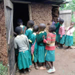 The Water Project: Gemeni Salvation Primary School -  Girls Queue For Latrines