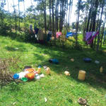 The Water Project: Mukhangu Community, Okumu Spring -  Water Containers Scattered At A Compound In The Community