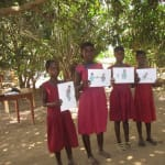 The Water Project: Sankoya Community, Prophecy Primary School -  Holding Up Cards During Training