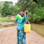 The Water Project: Kitandini Community -  Carrying Water
