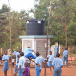The Water Project: Mbuuni Primary School -  Playing In Front Of Water Tank