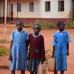 The Water Project: Mbuuni Primary School -  Students Carrying Water Containers