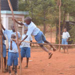 The Water Project: Mbuuni Primary School -  Students Pole Vaulting