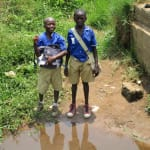 The Water Project: Tulun Community, Hope Assembly of God School and Church -  Boys Stand At Alternate Water Source