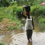 The Water Project: Tulun Community, Hope Assembly of God School and Church -  Carrying Water