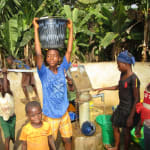 The Water Project: Pewullay Primary School -  Kids Carrying Water