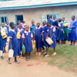 The Water Project: Bumuyange Primary School -  Girls Getting Ready To Fetch Water