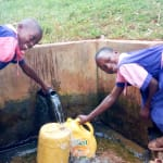 The Water Project: Bumuyange Primary School -  Fetching Water