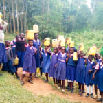 The Water Project: Bumuyange Primary School -  Posing With Jerrycans