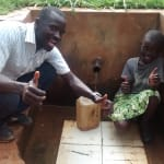 The Water Project: Nyira Community, Ondiek Spring -  Thumbs Up For Reliable Water