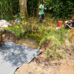 The Water Project: Mukhangu Community, Okumu Spring -  Laying The Foundation