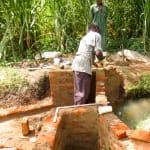 The Water Project: Mukhangu Community, Okumu Spring -  Spring Protection Construction