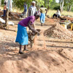 The Water Project: Ndiani Primary School -  Sifting Sand For Tank Construction