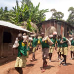 The Water Project: Gemeni Salvation Primary School -  Carrying Materials To The Artisans