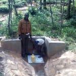 The Water Project: Mkunzulu Community, Museywa Spring -  Field Officer Wilson Kipchoge And Clarence Akanga