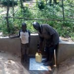 The Water Project: Mkunzulu Community, Museywa Spring -  Shadrack Mwochi With Clarence Askanga