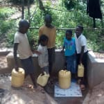The Water Project: Mkunzulu Community, Museywa Spring -  Children At The Spring