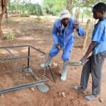 The Water Project: Mbuuni Primary School -  Cementing The Handwashing Station Platform