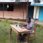 The Water Project: Kapkemich Primary School -  Teachers Outside Grading