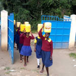 The Water Project: Kapkemich Primary School -  Arriving At School With Water Again