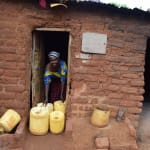 The Water Project: Kathungutu Community -  Posing With Water Containers At Home