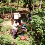 The Water Project: Hirumbi Community, Khalembi Spring -  Carrying Water