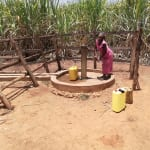 The Water Project: Rubana Yagilewo Community -  A Woman Collectiong Water From Alternative Source