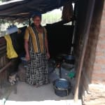 The Water Project: Rubana Yagilewo Community -  A Woman Cooking In The Kitchen