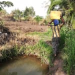 The Water Project: Rubana Yagilewo Community -  Carrying Water From Open Source