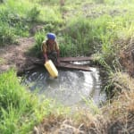 The Water Project: Rubana Yagilewo Community -  Filling Container At An Open Source