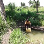 The Water Project: Rubana Yagilewo Community -  Filling Container At Open Source