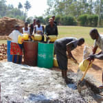 The Water Project: Kigulienyi Primary School -  Students Delivering Water For Mixing Cement