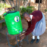 The Water Project: Kapkemich Primary School -  Agatha Washing Her Hands
