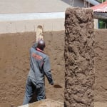 The Water Project: Kigulienyi Primary School -  Plastering The Tank Wall
