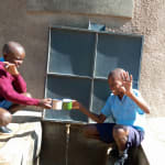 The Water Project: Kapkemich Primary School -  Amos And Brian At The Tank