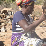 The Water Project: Kathungutu Community -  Breaking Rocks