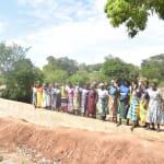 The Water Project: Kathungutu Community -  Shg Members Celebrate New Dam