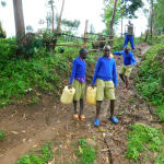 The Water Project: Kapkures Primary School -  Sliding On Muddy Road To The Spring